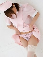 Pretty Asian nurse in stockings