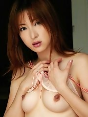 Asian babe in red lingerie slowly strips