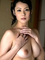 Mature and lovely Japanese av idol Nana Aida lies outdoor naked for you
