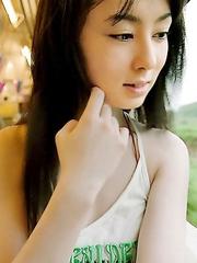 Rina Akiyama with sexy lips rubs her cunt of bar outdoor