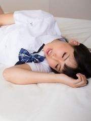 Sexy schoolgirl Natsuki Yokoyama wears pantyhose in a hot thighjob gallery