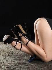 Leggy brunette Kotomi Shinosaki sucking on her finger while showing those legs