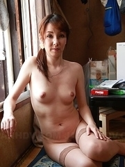 Asian Chika Sasaki strips to show round boobs