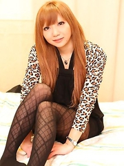 Minami Itao taking her clothes off to show her nice titties and play with her hairy pussy