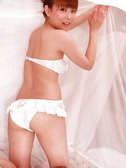 Satomi Shigemori in white lingerie plays with bride veil